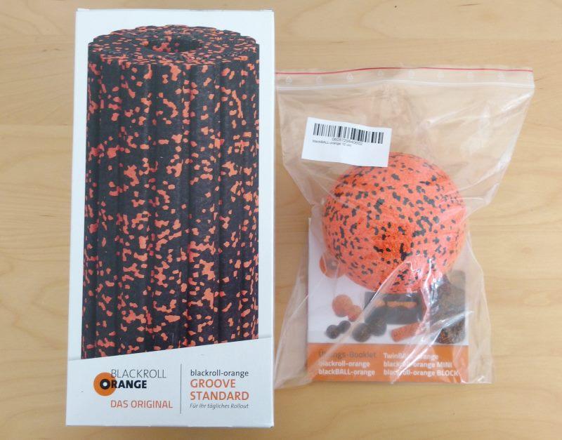 Blackroll-Orange Selbstmassagerolle und blackBall Massageball mit Verpackung